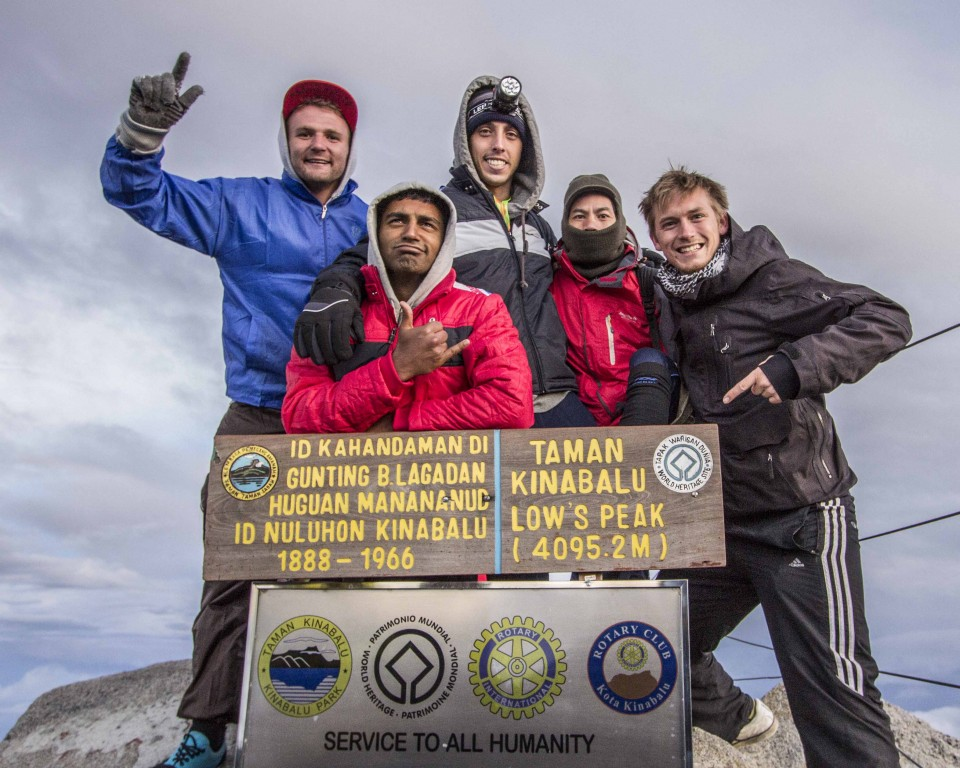 Group photo at the summit after climbing kinabalu