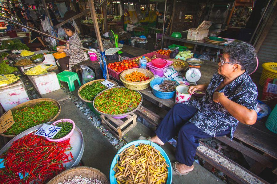 Locals selling produce at the Bangkok Train Market