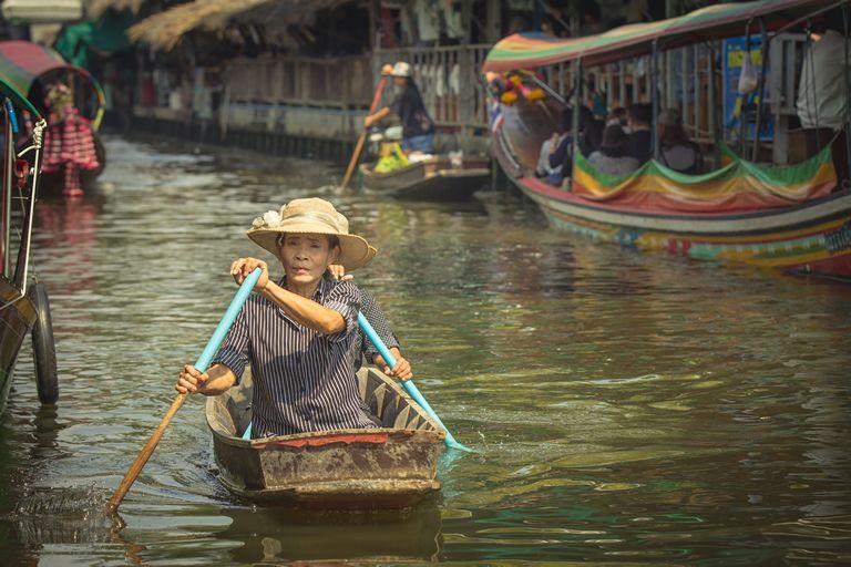 Woman rowing boat at Khlong Lat Mayom Floating Market Bangkok