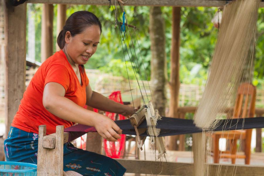 Laos Woman Hand Weaving in Muang Ngoi